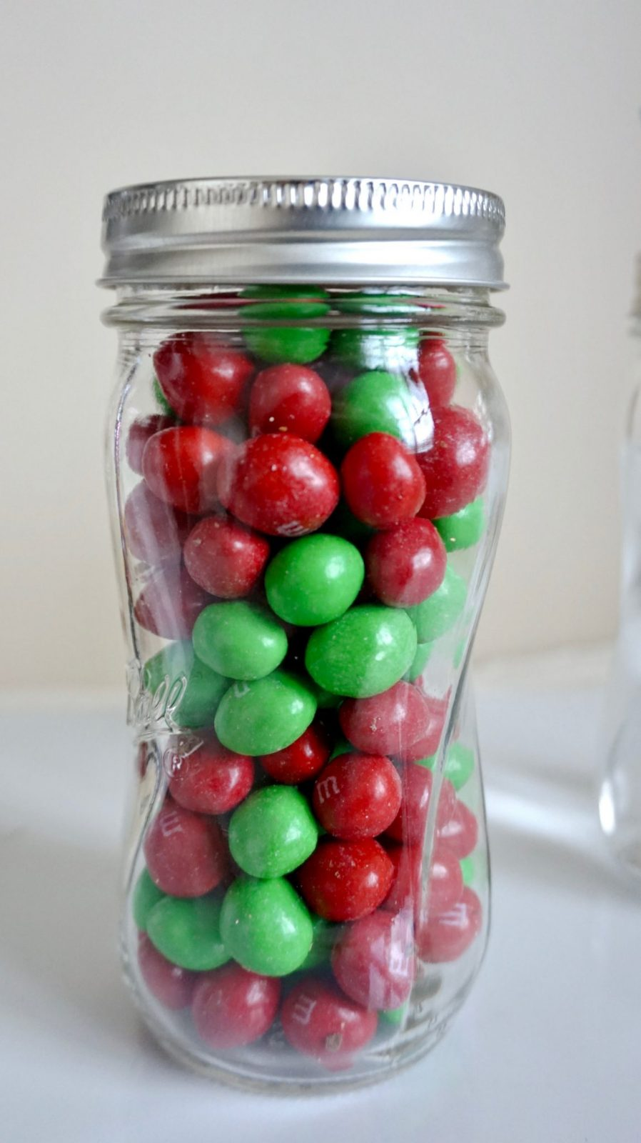 Putting candy in mason jars
