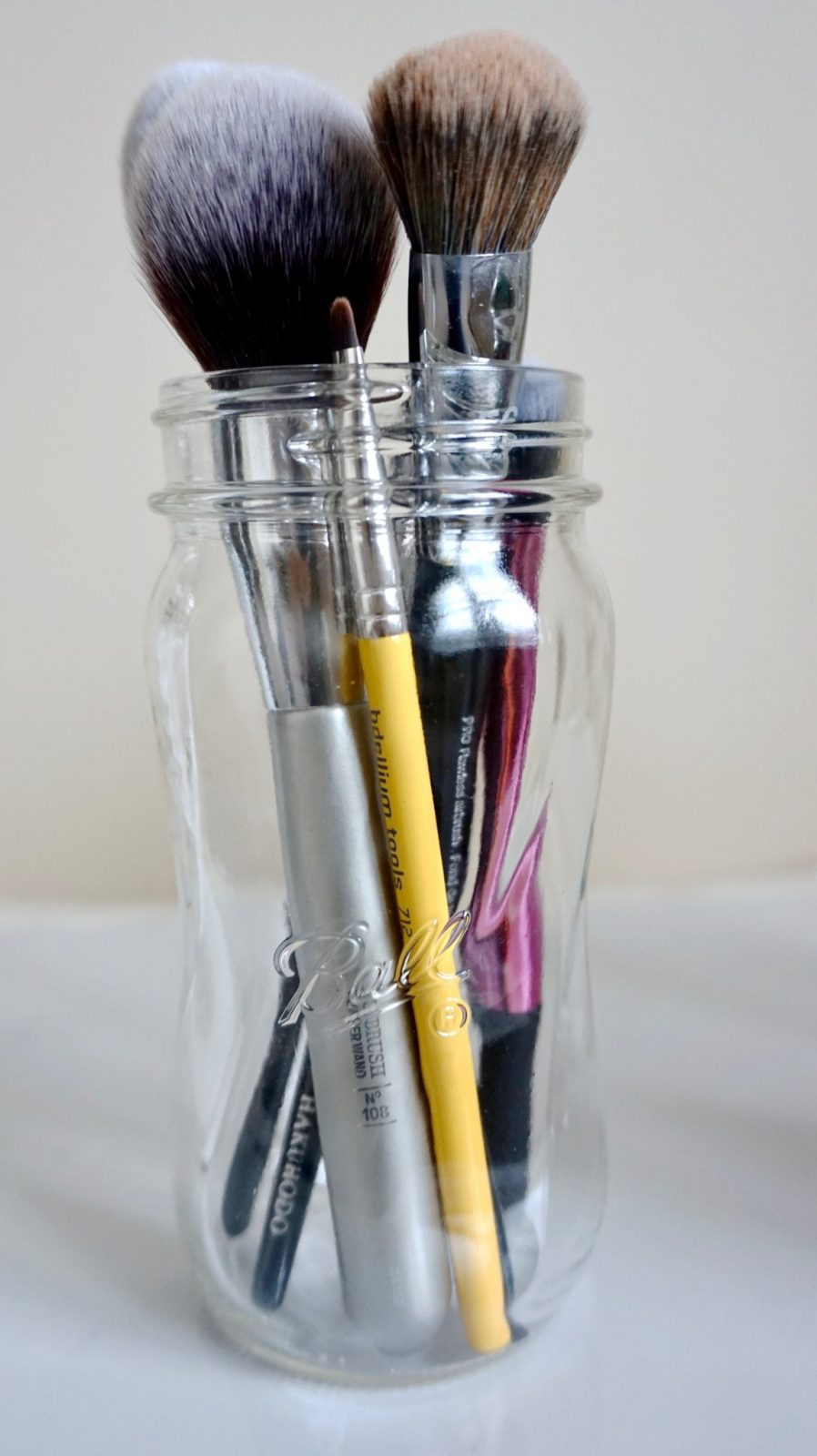Storing makeup brushes in mason jars